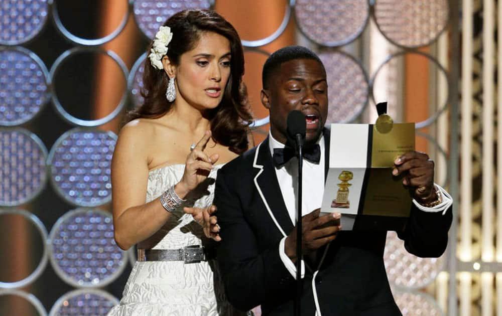 Salma Hayek, left, and Kevin Hart present an award at the 72nd Annual Golden Globe Awards.