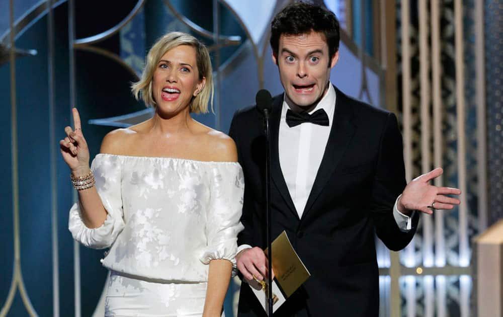 Kristen Wiig, left, and Bill Hader present an award at the 72nd Annual Golden Globe Awards .