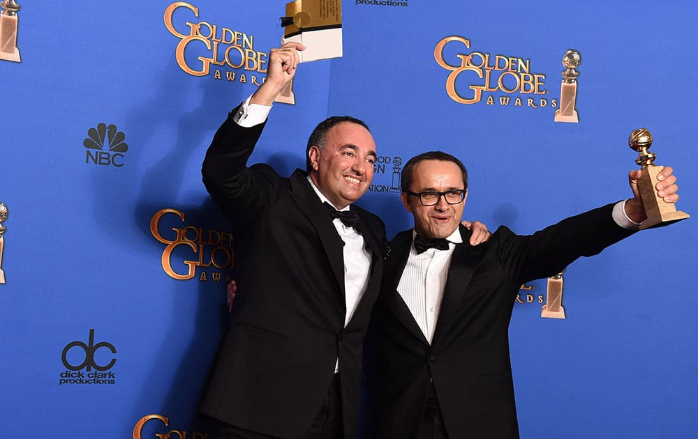 Alexander Rodnyansky, left, and Andrey Zvyagintsev pose in the press room with the award for best foreign film for