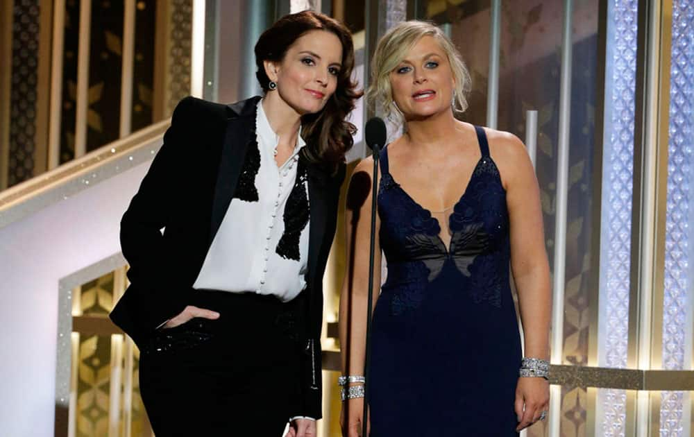 co-hosts Tiny Fey, left, and Amy Poehler speak at the 72nd Annual Golden Globe Awards.