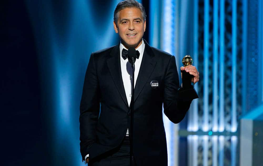 George Clooney accepts the Cecil B. DeMille Award at the 72nd Annual Golden Globe Awards.