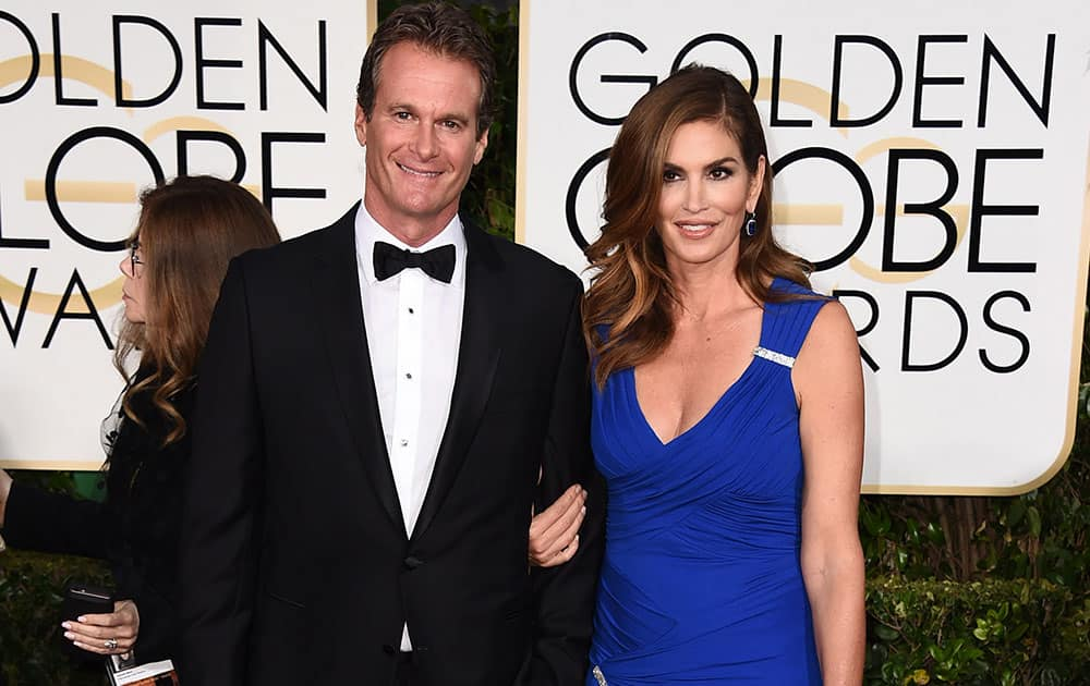 Rande Gerber, left and Cindy Crawford arrive at the 72nd annual Golden Globe Awards.