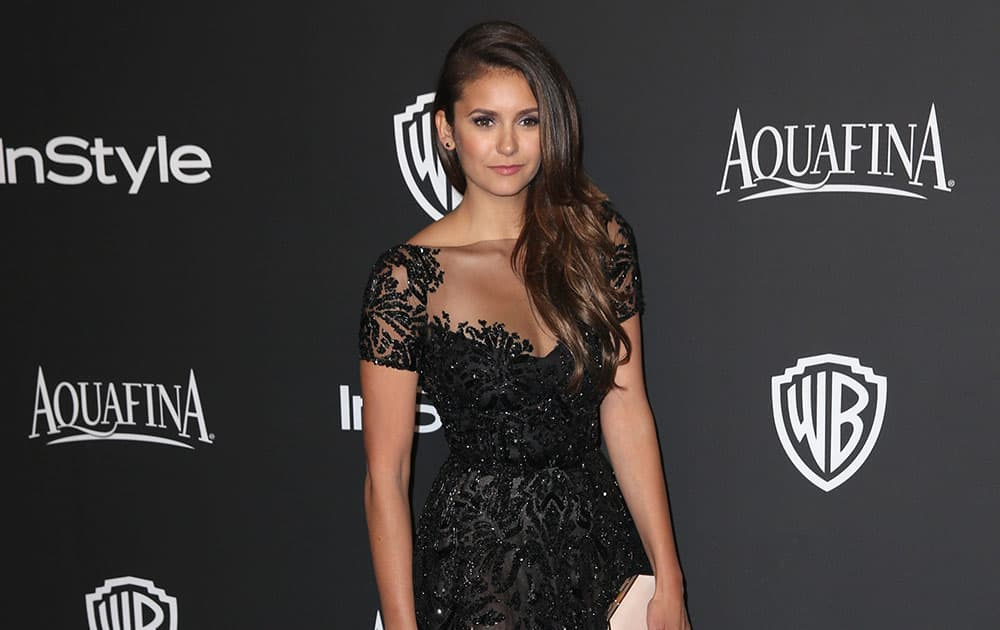 Nina Dobrev arrives at the 16th annual InStyle and Warner Bros. Golden Globes afterparty at the Beverly Hilton Hotel.