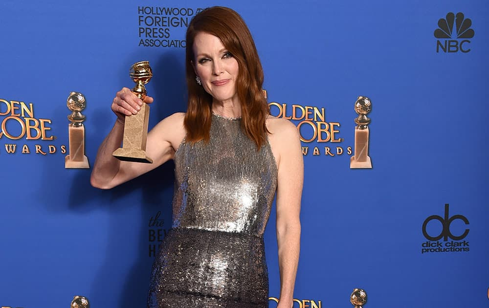 """Julianne Moore poses in the press room with the award for best actress in a motion picture - drama for """"Still Alice"""" at the 72nd annual Golden Globe Awards."""