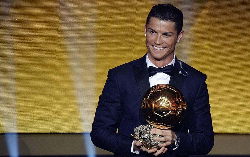 Cristiano Ronaldo of Portugal reacts after winning the FIFA Mens soccer player of the year 2014 prize at the FIFA Ballon d'Or awarding ceremony at the Kongresshaus in Zurich.