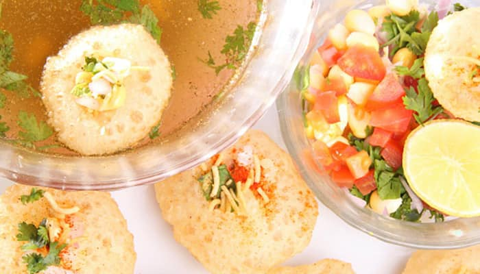 Puri's stuffed with boiled white peas are dipped in tangy flavoured water and served. You may ask for a potato stuffing too!