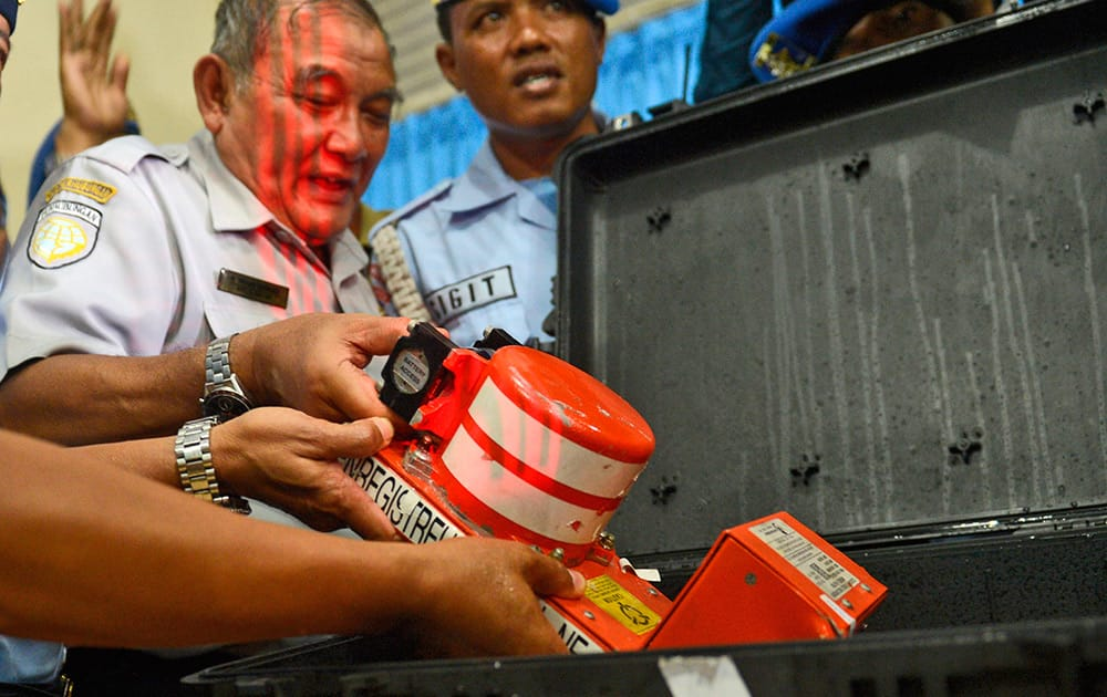 Head of Indonesian National Transportation Safety Committee Tatang Kurniadi, shows, the newly recovered Cockpit Voice Recorder from the ill-fated AirAsia Flight 8501 during a press conference in Pangkalan Bun, Central Borneo, Indonesia.