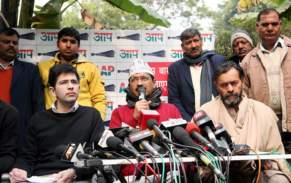 AAP chief Arvind Kejriwal addresses a press conference with AAP leader Yogendra Yadav in New Delhi.