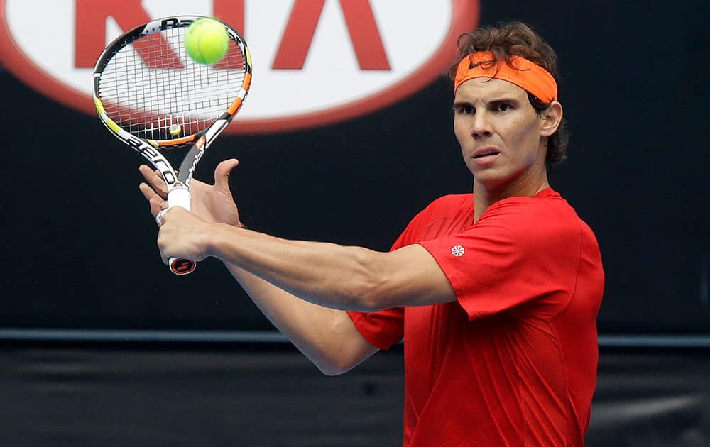 Spain's Rafael Nadal makes a backhand return during a practice session on Margaret Court Arena ahead of the Australian Open tennis championship in Melbourne.