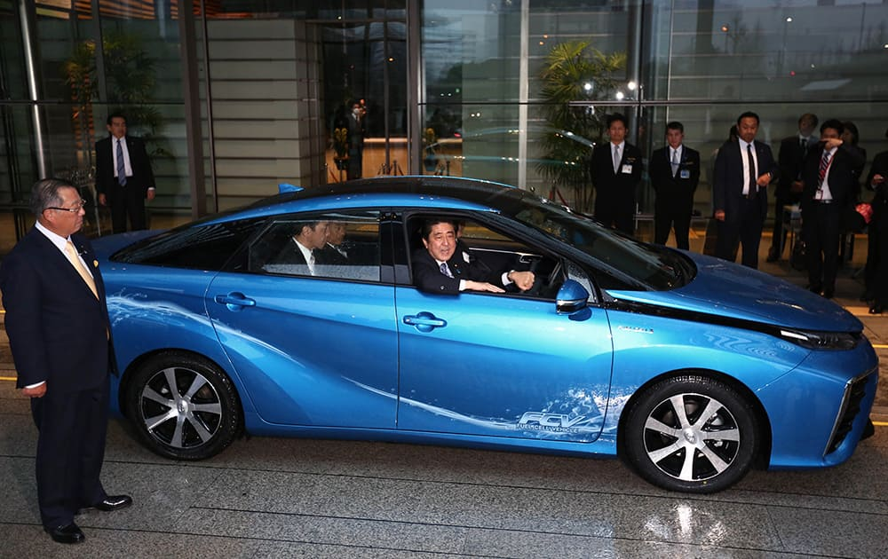 Japanese Prime Minister Shinzo Abe speaks after he drove a Toyota's new commercial fuel cell vehicle during a ceremonial test drive at the prime minister's office in Tokyo.
