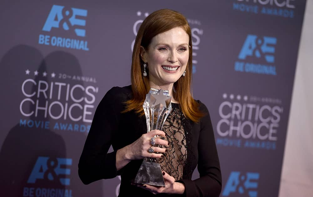 Julianne Moore, winner of the best actress award for 'Still Alice,' poses in the press room at the 20th annual Critics' Choice Movie Awards at the Hollywood Palladium, in Los Angeles.