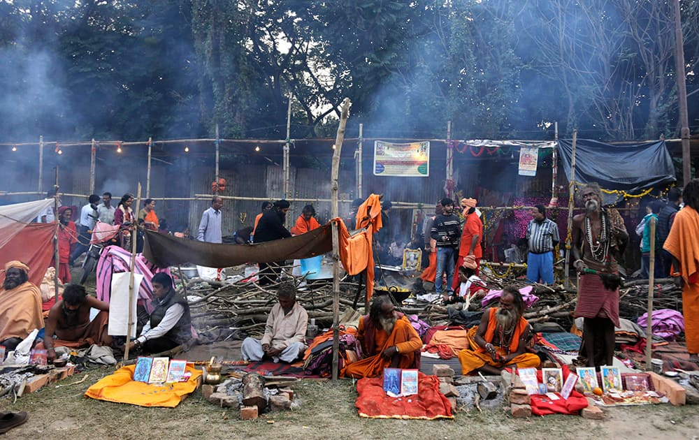 Pilgrims and sadhus, or Hindu holy men, set up their resting space at a transit camp on the way to Gangasagar, in Kolkata.