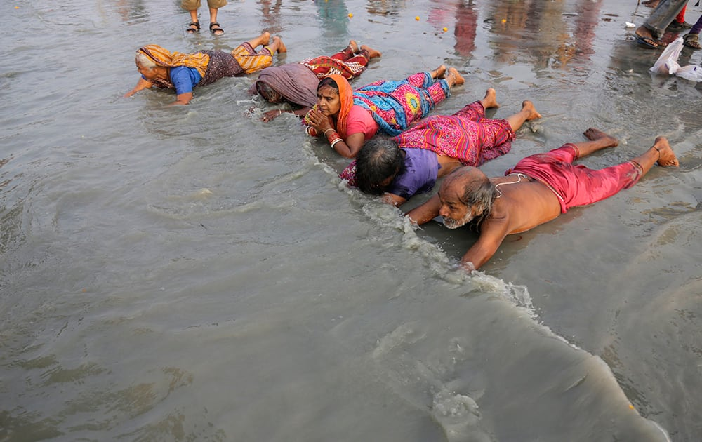 Hindu pilgrims offer prayers prior to taking a holy dip in Gangasagar.