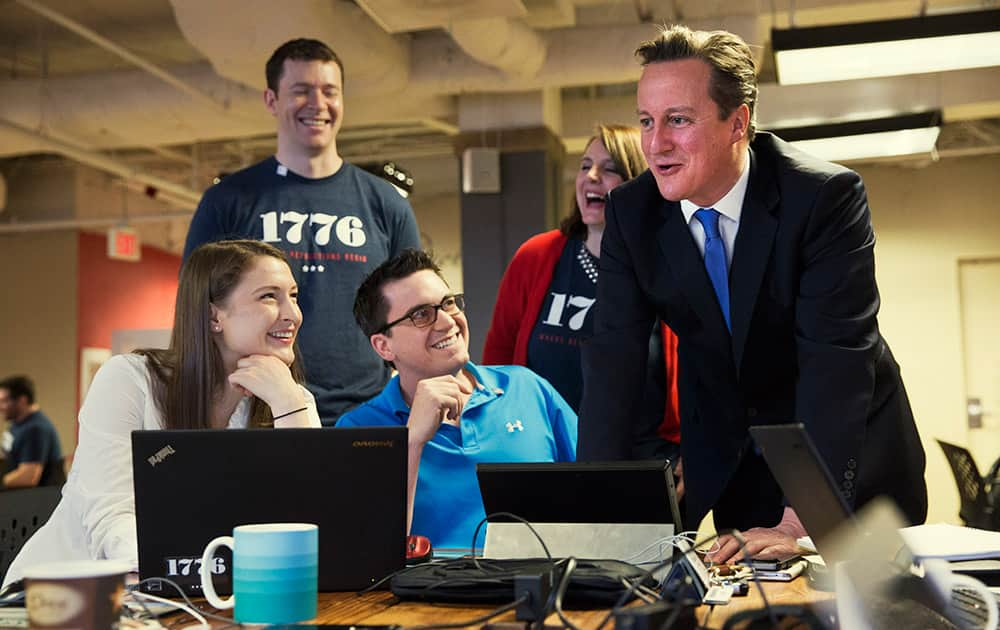 British Prime Minister David Cameron talks with people working at '1776', a hub for tech startups, in Washington, before his meeting with President Barack Obama at the White House.