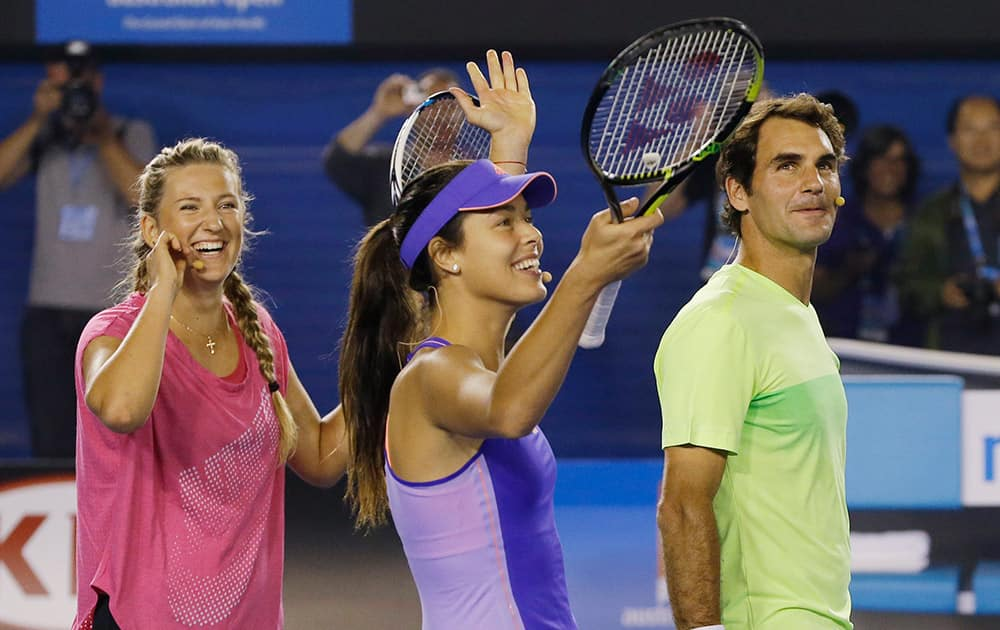 Victoria Azarenka of Belarus, left, Ana Ivanovic of Serbia and Switzerland's Roger Federer celebrate after winning their team event at the Kids Tennis Day on Rod Laver Arena ahead of the Australian Open tennis championship in Melbourne, Australia.