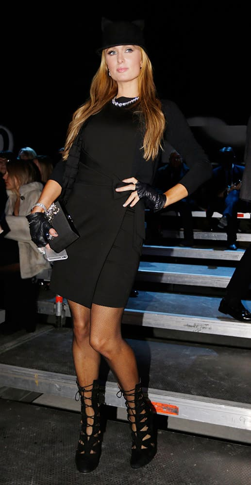 Paris Hilton arrives to attend the men's Fall-Winter 2015-2016 Dsquared2 fashion show, part of the Milan Fashion Week, unveiled in Milan, Italy,