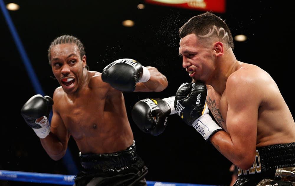 Amir Imam hits Fidel Maldonado Jr. during their boxing bout in Las Vegas.