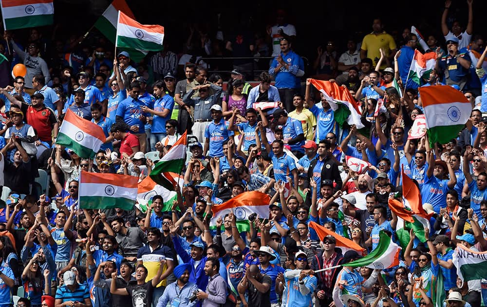 Indian fans cheer on their team while playing against Australia during their one-day international cricket match in Melbourne.