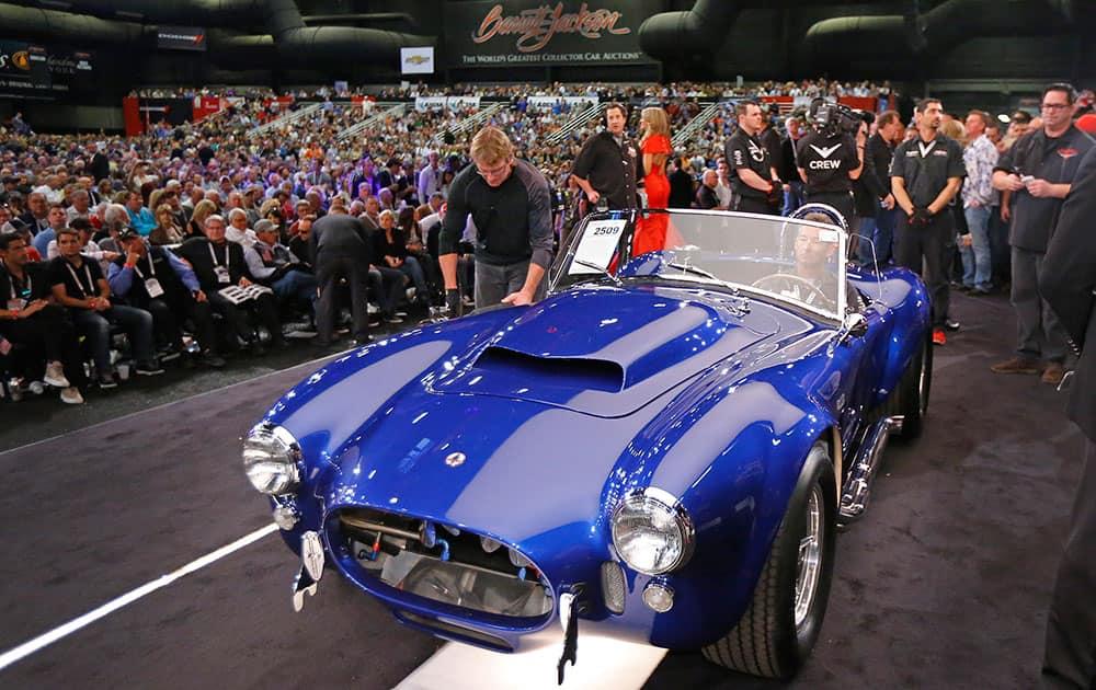 The Shelby Cobra 427 Super Snake sells for $4,700,000 at the Barrett-Jackson auction in Scottsdale, Ariz.