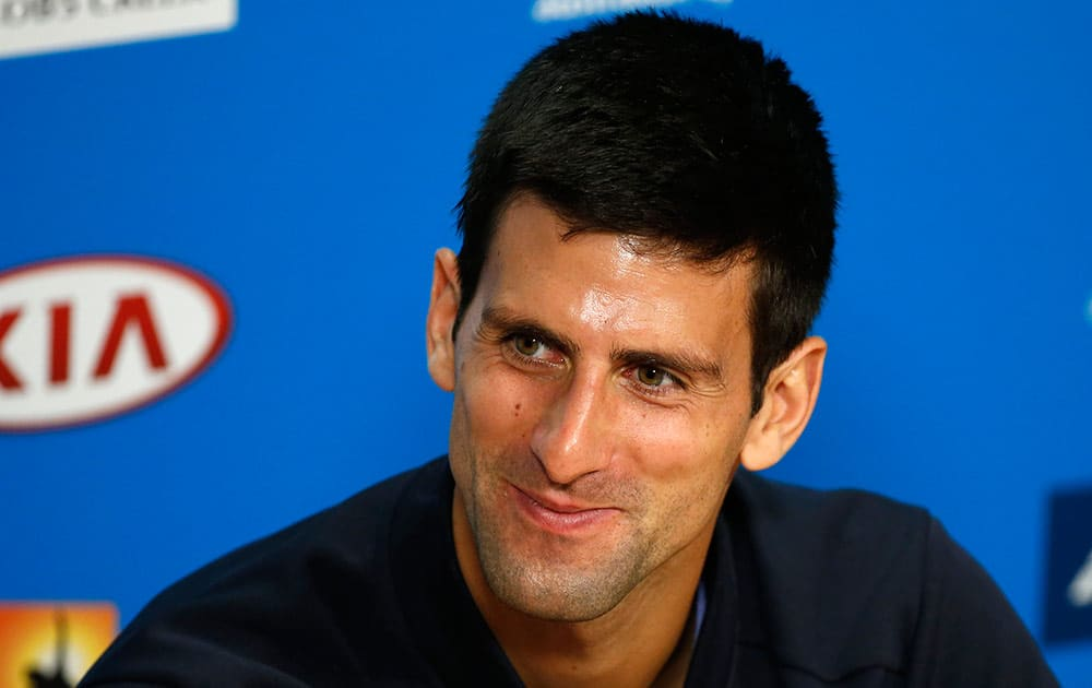 Novak Djokovic of Serbia smiles during a press conference at the Australian Open tennis championship in Melbourne, Australia, Sunday.