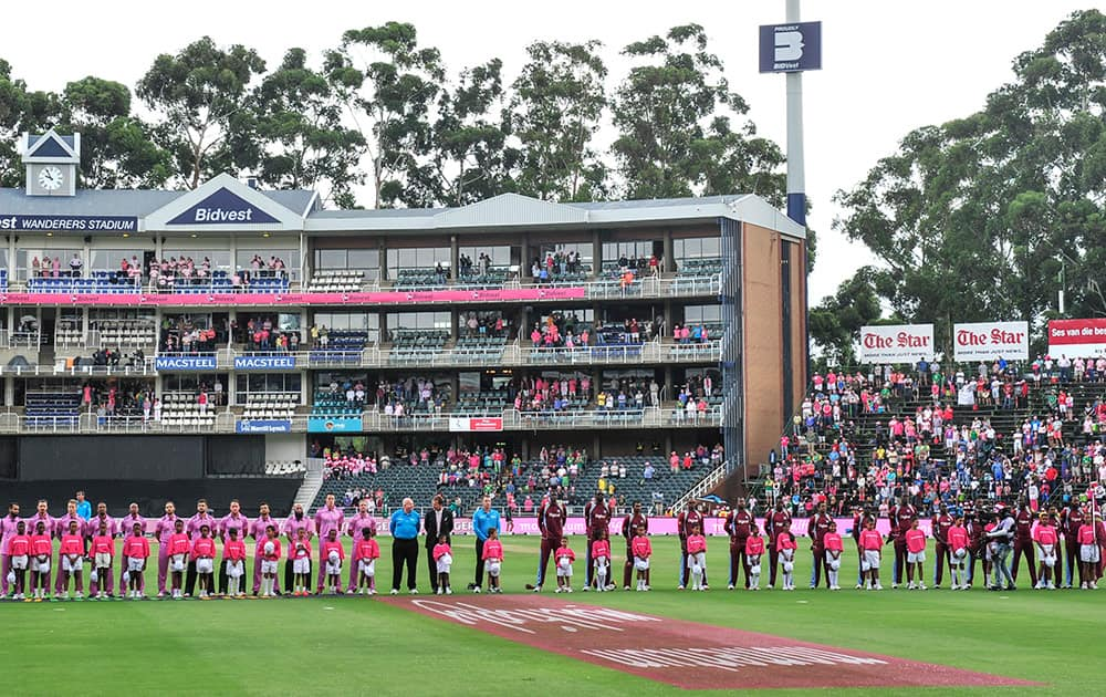 South Africa and the West Indies cricket team players sing their national anthems during the second ODI in Johannesburg, South Africa, Sunday, Jan 18, 2015.