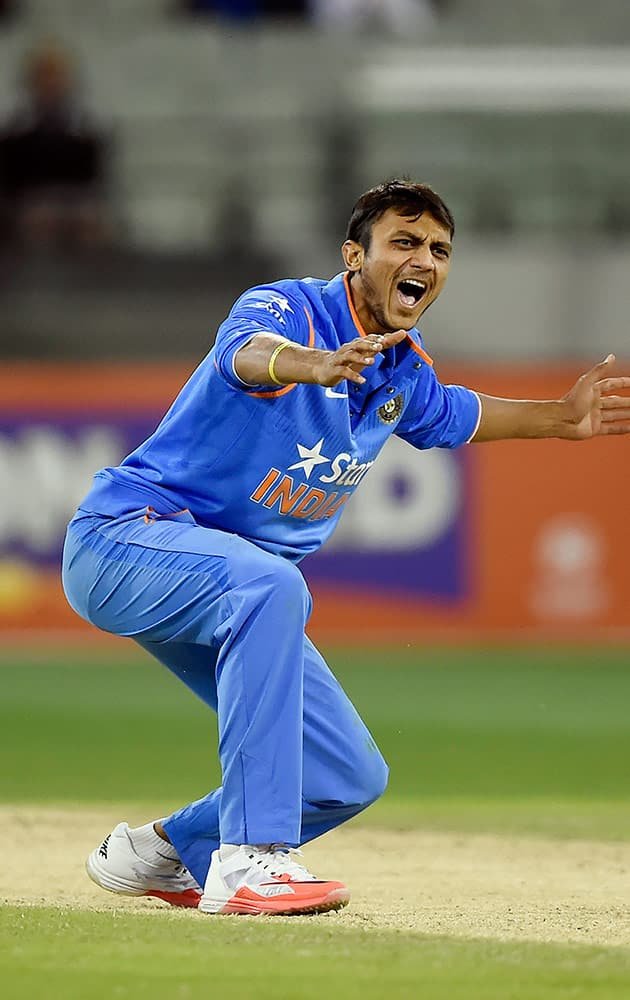 India's Akshar Patel unsucessfully appeals for an LBW against Australia's James Faulkner during their One Day International cricket match in Melbourne, Australia, Sunday.