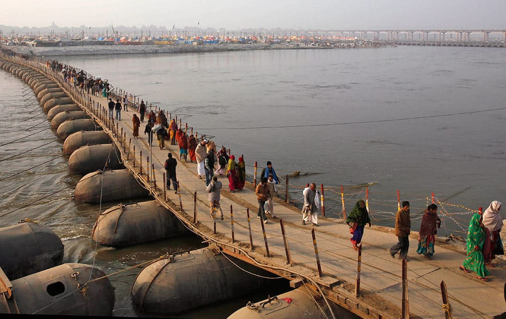 "Hindu devotees cross a temporary pontoon bridge at Sangam, the confluence of the Rivers Ganges, Yamuna and mythical Saraswati during the annual traditional fair of ""Magh Mela"" in Allahabad, India, Sunday."