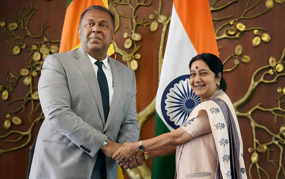 India's Foreign Minister Sushma Swaraj, right, poses with her Sri Lankan counterpart Mangala Samaraweera in New Delhi, India, Sunday. Samaraweera is on a three-day official visit to the country.