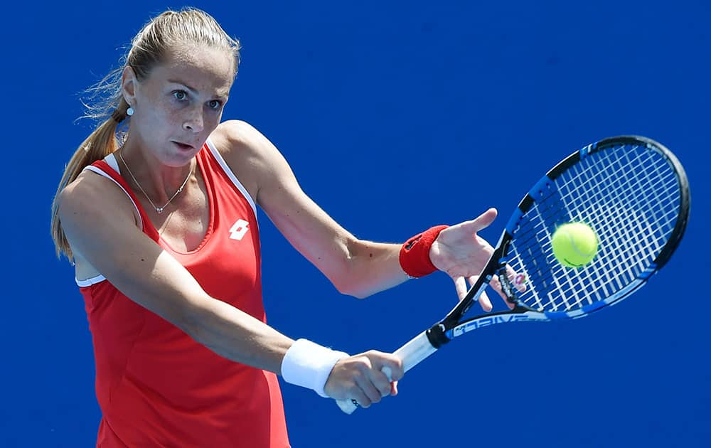 Magdalena Rybarikova of Slovakia makes a backhand Ana Konjuh of Croatia during their first round match at the Australian Open tennis championship in Melbourne.