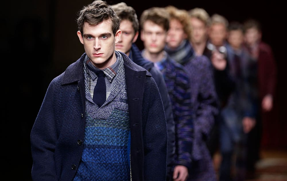 Models wear creations for Missoni men's Fall - Winter 2015-2016 collection, part of the Milan Fashion Week.