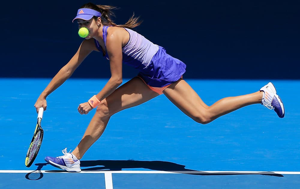 Ana Ivanovic of Serbia chases down a shot to Lucie Hradecka of the Czech Republic during their first round match at the Australian Open tennis championship in Melbourne.