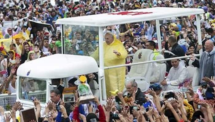 Pope Francis winds up Asia tour, draws record turnout at rain-soaked Mass in Manila