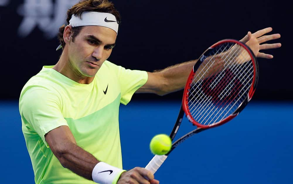 Roger Federer of Switzerland makes a backhand return to Lu Yen-Hsun of Taiwan during their first round match at the Australian Open tennis championship in Melbourne.