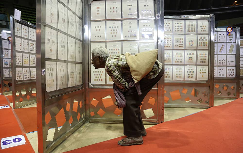 A visitor keenly browses through the exhibits of stamps and other postal material at Karnapex 2015 in Bangalore. Karnapex 2015, a philatelic exhibition organized by Indian postal department has more than 15,000 stamps, post cards and other related material from different countries across the world.