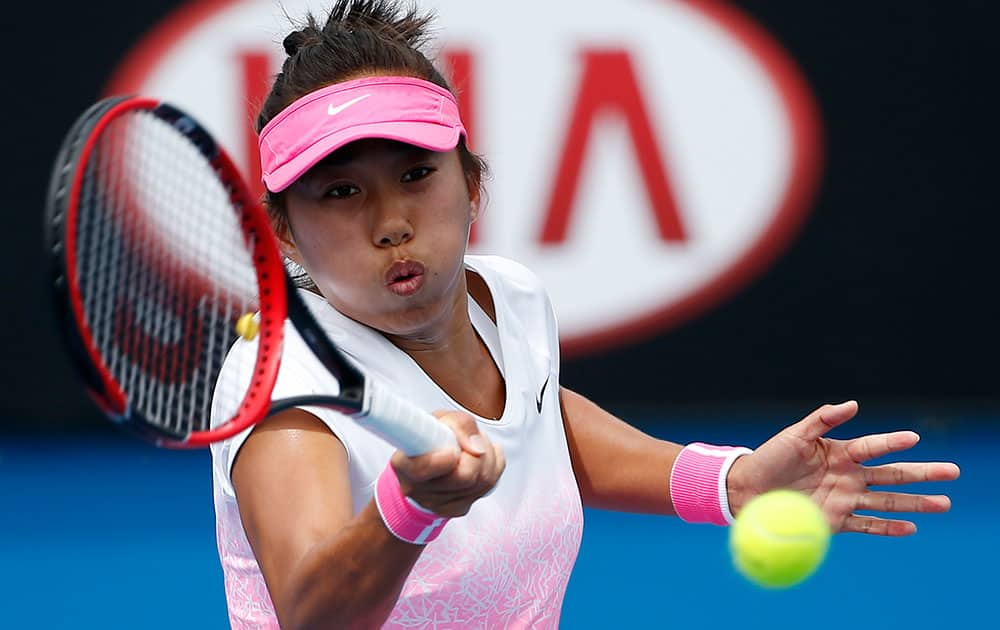 Zhang Shuai of China makes a forehand return to Alize Cornet of France during their first round match at the Australian Open tennis championship in Melbourne.
