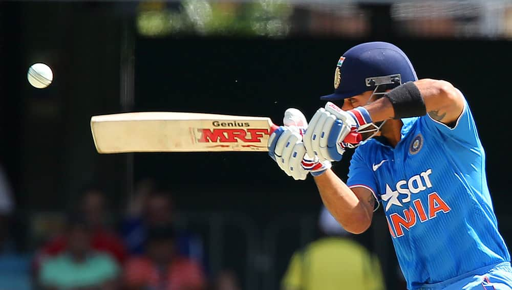 Virat Kohli nicks the ball that has him caught behind for 4 runs against England during their one day International cricket match in Brisbane, Australia.