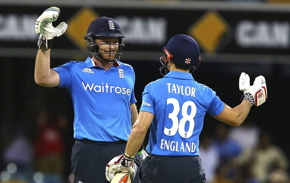 England's Ian Bell, and James Taylor, celebrate after England won the one day International cricket match against India in Brisbane, Australia.
