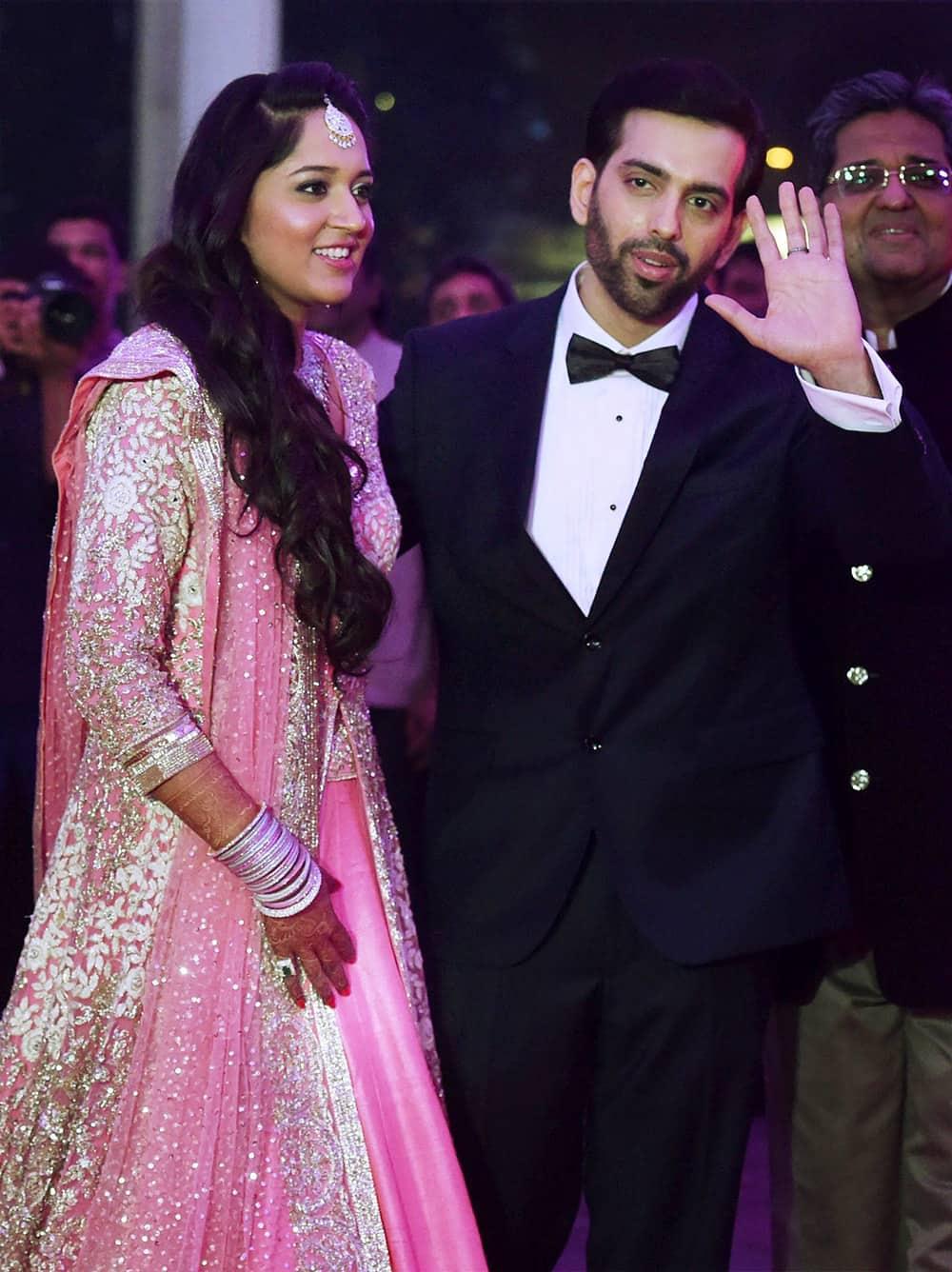 Shatrughan Sinhas son Kussh and Taruna Agarwal during their wedding reception in Mumbai.