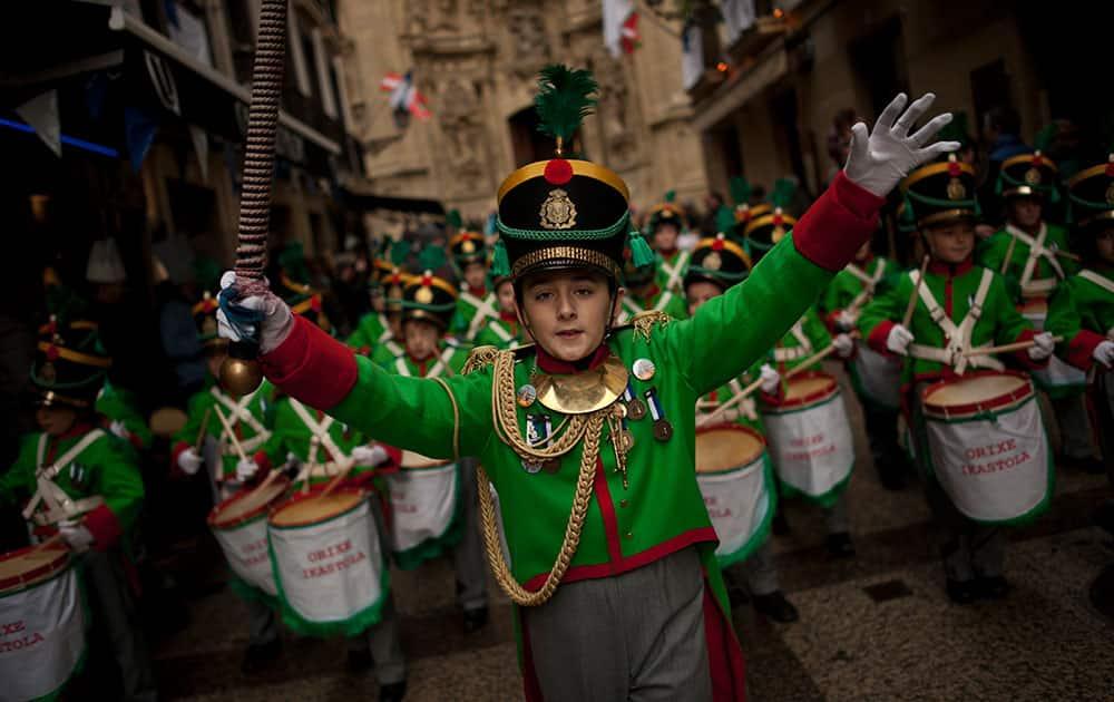 ''Tamborilleros'' wearing their uniforms march in the traditional ' La Tamborrada', during 'El Dia Grande', the main day of San Sebastian feasts, in the Basque city of San Sebastian, northern Spain.