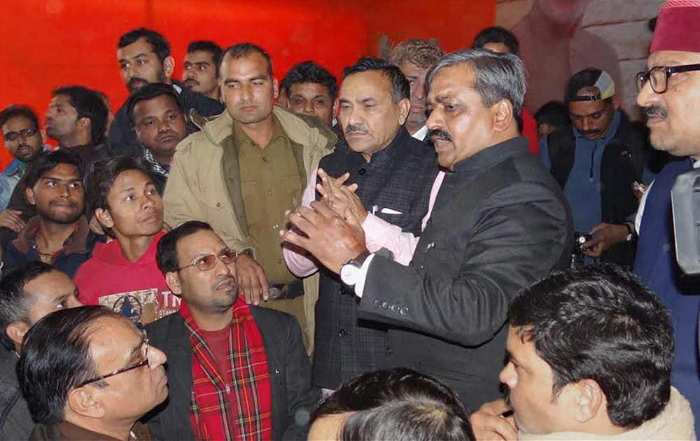 Delhi BJP President Satish Upadhyay talking to his supporters protesting at Delhi BJP office in new Delhi.
