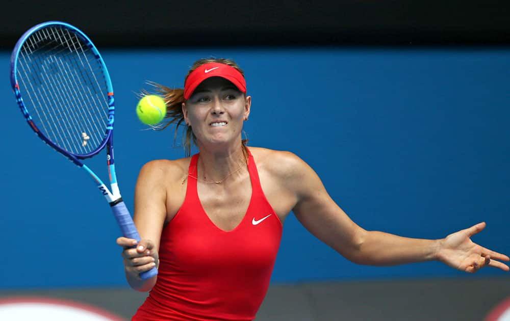 Maria Sharapova of Russia makes a forehand return to Alexandra Panova of Russia during their second round match at the Australian Open tennis championship in Melbourne.
