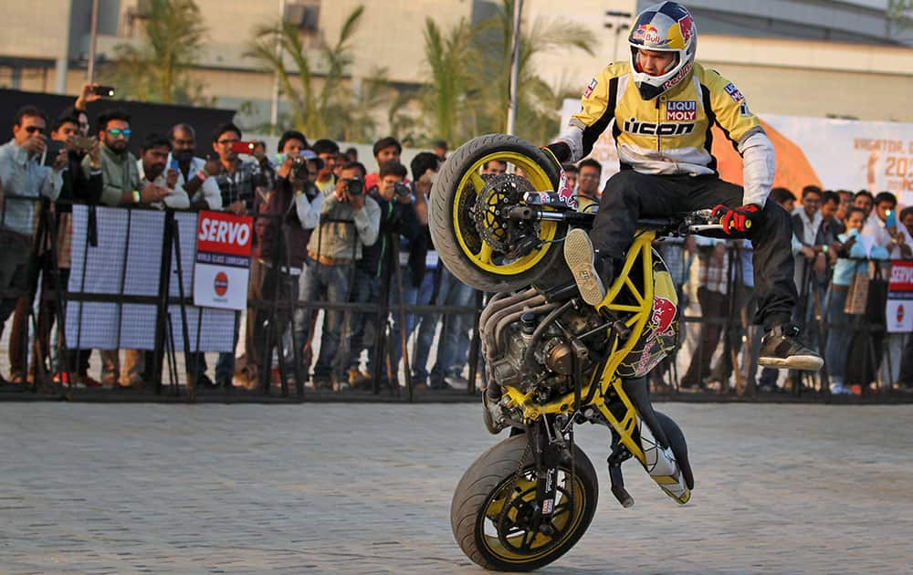 uropean motorcycle stunt rider Aras Gibieza performs during the India Bike Week (IBW) tour in Ahmadabad, India.