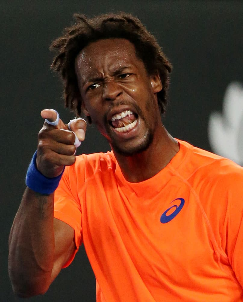 Gael Monfils of France disputes a line call as he plays his compatriot Lucas Pouille during their first round match at the Australian Open tennis championship in Melbourne.