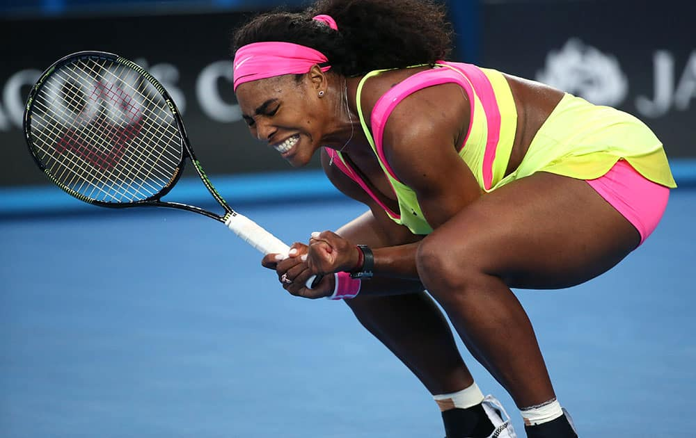 Serena Williams of the US celebrates a point won against Alison Van Uytvanck of Belgium during their first round match at the Australian Open tennis championship in Melbourne.