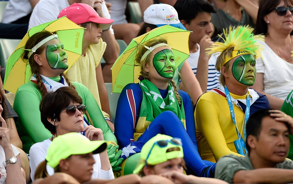 Face painted fans watch the second round match between Nick Kyrgios of Australia and Ivo Karlovic of Croatia at the Australian Open tennis championship in Melbourne.