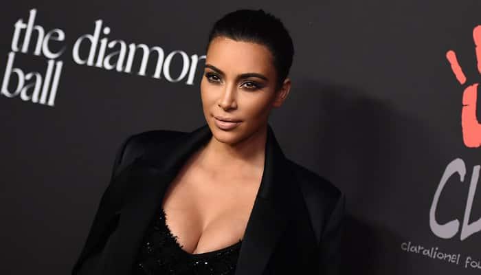 Kim Kardashian flaunts cleavage for 'Selfish'