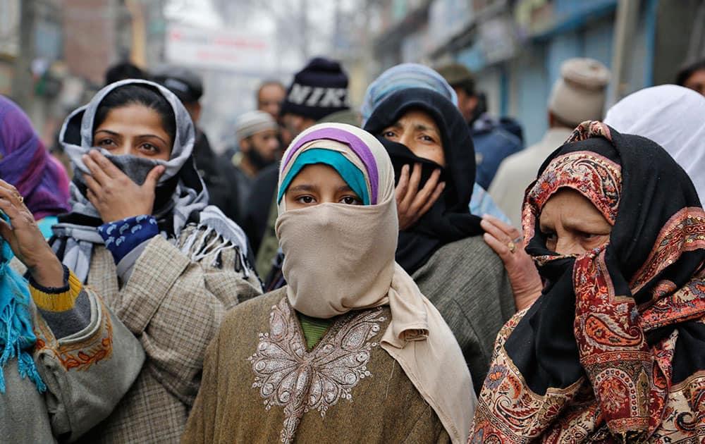 Kashmiri women listen to Yasin Malik as he speaks during a memorial service to mark the anniversary of an alleged massacre in Srinagar, India.