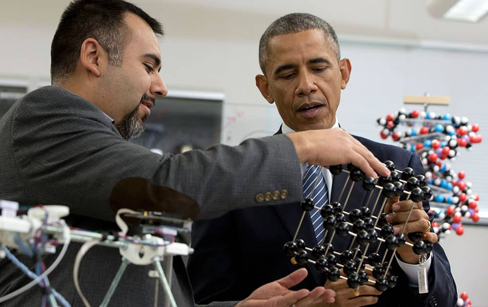 President Barack Obama talks with Professor Dave Estrada as he tours the new Product Development Lab in Boise State University's Micron Engineering Center, in Boise , Idaho, before speaking about the themes in his State of the Union address.