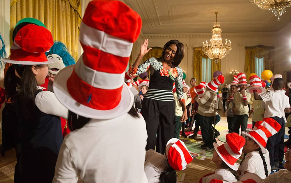 First lady Michelle Obama greets local students after reading to them as part of her
