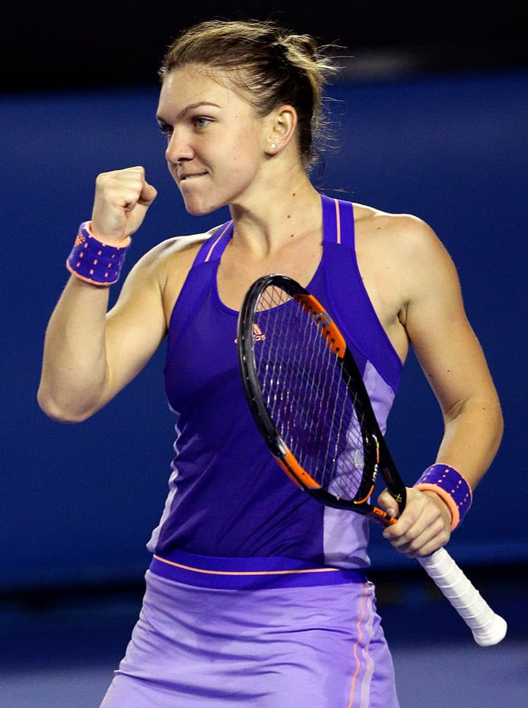 Simona Halep of Romania celebrates after defeating Jarmila Gajdosova of Australia during their second round match at the Australian Open tennis championship in Melbourne.